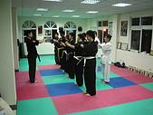 散打昇級晉段與競賽:散打昇級開始行中式抱拳禮