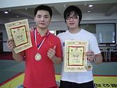 散打昇級晉段與競賽:泰佑家彭選手合影